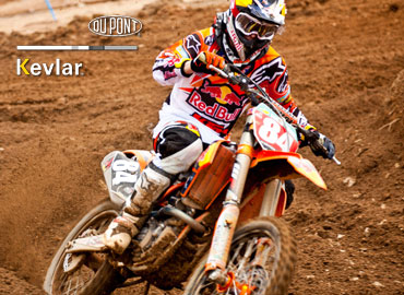 Motorbiker wearing abrasion resistant clothing
