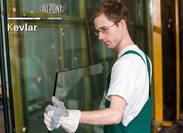 Glass installer using cut resistant gloves
